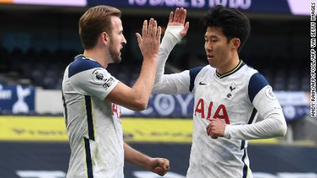 Harry Kane celebrates with Son Heung-min after putting Tottenham Hotspur ahead against Leeds United.  Sun later scored the second goal in a 3--0 victory.